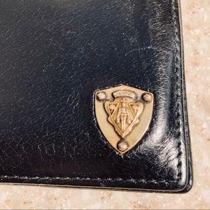 Men's Gucci bifold black leather wallet.